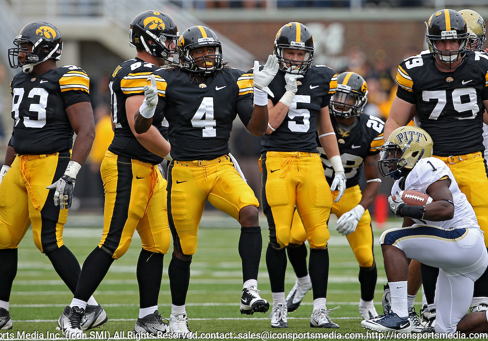 September 17, 2011: Iowa Hawkeyes defensive back Jordan Bernstine (4) is pumped up after a hit during the first half of the game between the Iowa Hawkeyes and the Pittsburgh Panthers at Kinnick Stadium in Iowa City, Iowa on Saturday, September 17, 2011. Iowa defeated Pittsburgh 31-27.