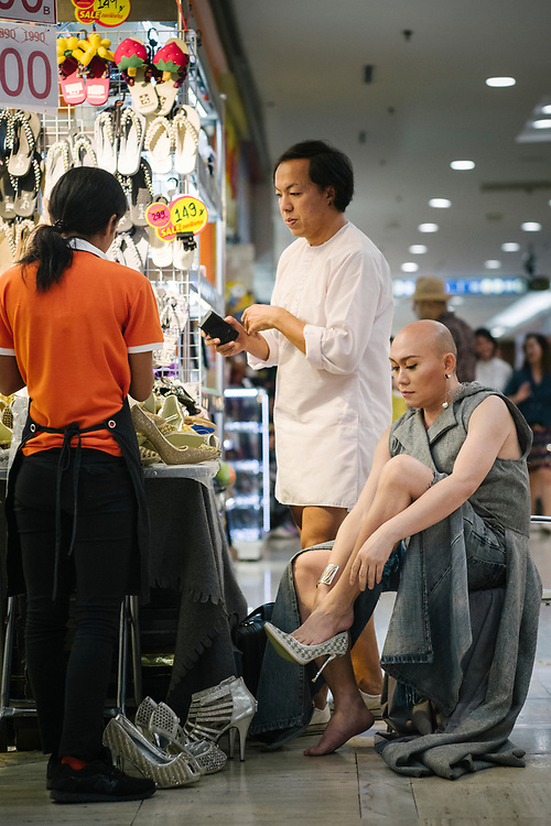 "Bangkok January 2018,<br /> Chana Lanna, ""She"" is a famous transgender in Bangkok. At the MBK Fashion Mall, ""She"" gets her new shoes ... size 43.