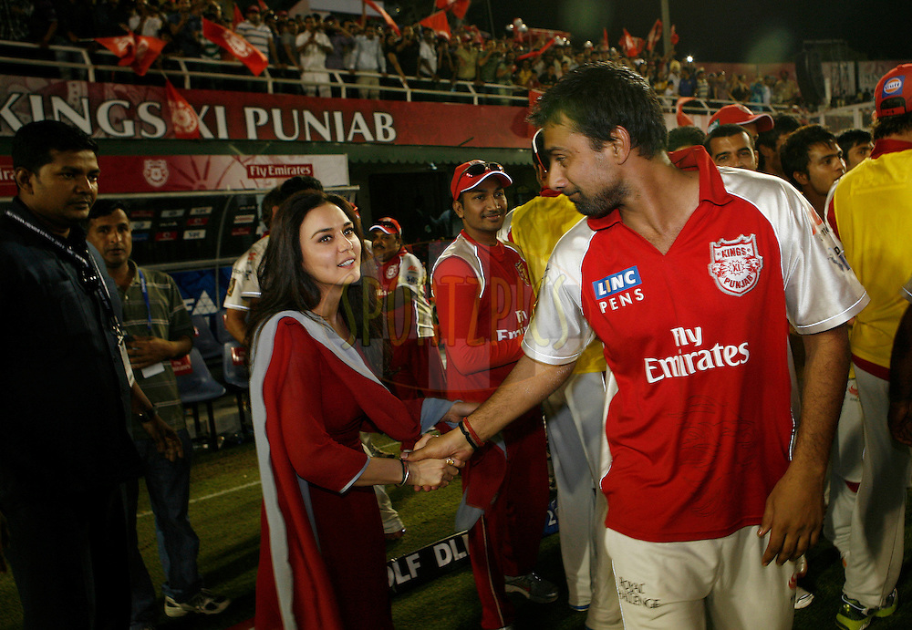 Owner of Kings XI Punjab Priety Zinta meets her team after winning the during match 9 of the Indian Premier League ( IPL ) Season 4 between the Kings XI Punjab and the Chennai Super Kings held at the PCA stadium in Mohali, Chandigarh, India on the 13th April 2011..Photo by Money Sharma/BCCI/SPORTZPICS