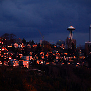 West slope of Queen Anne Hill and Seattle Space Needle at sunset from Ella Bailey City Park in Magnolia, Seattle, Washington