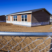 Newly erected homes fill the Navajo Housing Authority site near Ramah Tuesday.