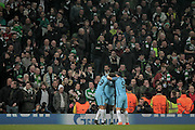 Manchester City players celebrate scoring the equaliser in front of the Celtic fans during the Champions League match between Manchester City and Celtic at the Etihad Stadium, Manchester, England on 6 December 2016. Photo by Mark P Doherty.
