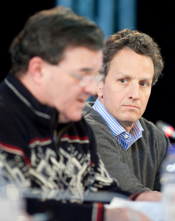 US Treasury Secretary Timothy Geithner listens as Canada's Minister of Finance, Jim Flaherty speaks during the final press conference for the G7 Finance Ministers Meeting in Iqaluit, Canada, February 6, 2010.<br /> AFP/GEOFF ROBINS/STR