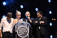 Wolf Alice accepting their award on stage