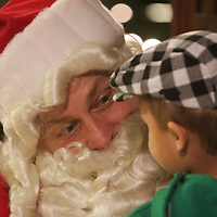 Santa Claus talks to Caiden Soto, 3, during the Greenfield Christmas Tree lighting at Greenfield Lake Park Thursday December 4, 2014 in Wilmington, N.C. (Jason A. Frizzelle)