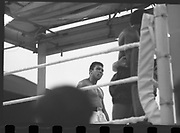 Ali vs Lewis Fight, Croke Park,Dublin.<br /> 1972.<br /> 19.07.1972.<br /> 07.19.1972.<br /> 19th July 1972.<br /> As part of his built up for a World Championship attempt against the current champion, 'Smokin' Joe Frazier,Muhammad Ali fought Al 'Blue' Lewis at Croke Park,Dublin,Ireland. Muhammad Ali won the fight with a TKO when the fight was stopped in the eleventh round.<br /> <br /> Image of Ali looking on as Al Lewis is led back to his corner after the referee stopped the fight.