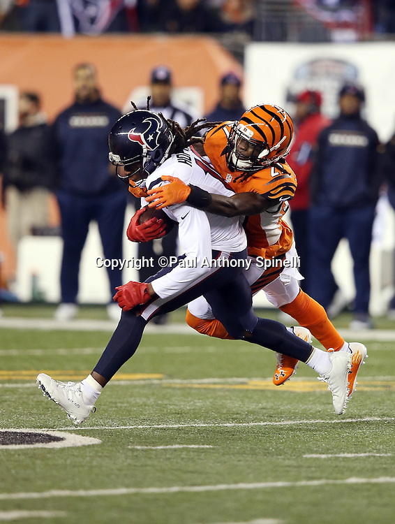 Houston Texans wide receiver DeAndre Hopkins (10) gets tackled by Cincinnati Bengals cornerback Dre Kirkpatrick (27) after catching a first down completed pass to the 46 yard line in the third quarter during the 2015 week 10 regular season NFL football game against the Cincinnati Bengals on Monday, Nov. 16, 2015 in Cincinnati. The Texans won the game 10-6. (©Paul Anthony Spinelli)