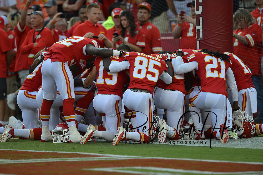 KANSAS CITY, MO - AUGUST 16:  Kansas City Chiefs players pray before a game against the San Francisco 49ers on August 16, 2013 at Arrowhead Stadium in Kansas City, Missouri.  (Photo by Peter G. Aiken/Getty Images) *** Local Caption ***