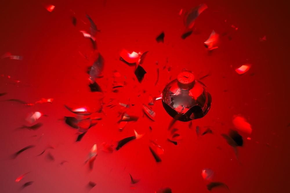 Broken Christmas ball on red