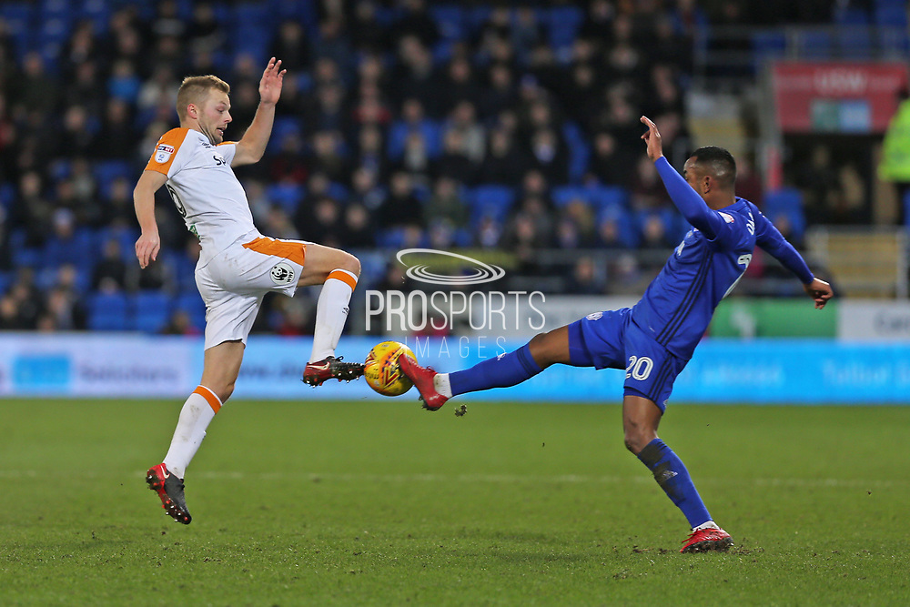 Hull City Sebastian Larsson (16) battles for the ball against   Cardiff City  Loic Damour (20) during the EFL Sky Bet Championship match between Cardiff City and Hull City at the Cardiff City Stadium, Cardiff, Wales on 16 December 2017. Photo by Gary Learmonth.