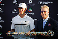 Rory McIlroy celebrates winning The DP World Tournaments with the trophy on the 4th day with Keith Pelley new Chief Executive Officer of the European Tour