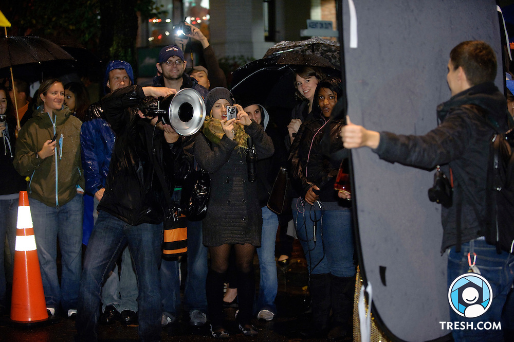 Photographer Nicholas Gingold takes portraits of racers prior to the 23rd annual High Heel Race held at 17th & Q Streets, NW, in Washington, D.C., Tuesday, October 27, 2009.