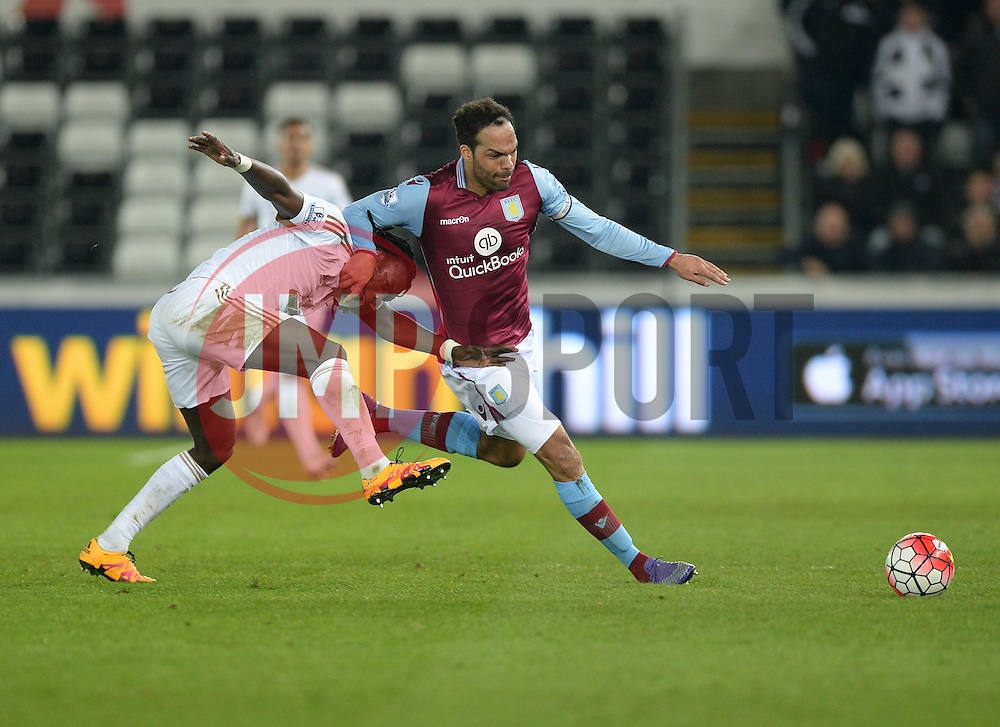 Joleon Lescott of Aston Villa fouls Bafetibis Gomis of Swansea City- Mandatory byline: Alex James /JMP - 19/03/2016 - FOOTBALL - The Liberty Stadium - Swansea, England - Swansea City v Aston Villa - Barclays Premier League