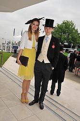 FRANCESCA HERBERT and ALEXANDER WARREN at the 2012 Investec sponsored Derby at Epsom Racecourse, Epsom, Surrey on 2nd June 2012.