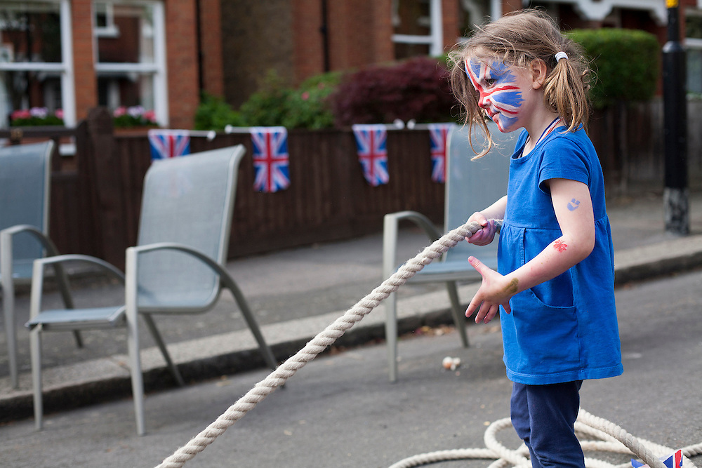 Anna Forser-Clarke, 4 years playing the tug of war as the party goes on at Desenfans Road, Dulwich to celebrate the Diamond Jubilee. London 2nd June 2012