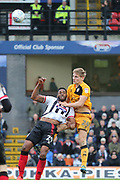 Grimsby Town forward Jamille Matt (29) and Port Vale defender Nathan Smith (24) battles for possession  during the EFL Sky Bet League 2 match between Grimsby Town FC and Port Vale at Blundell Park, Grimsby, United Kingdom on 10 March 2018. Picture by Mick Atkins.