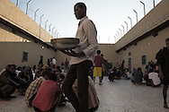 Libya, Garabulli: At Alguaiha detention center, migrants captured at the sea as they were attempting to reach Italy eat in the courtyard of the facility on May 12, 2015. Alessio Romenzi