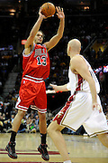 Apr 19, 2010; Cleveland, OH, USA; Chicago Bulls center Joakim Noah (13) shoots over Cleveland Cavaliers center Zydrunas Ilgauskas (11) during the third period in game two in the first round of the 2010 NBA playoffs at Quicken Loans Arena. The Cavaliers beat the Bulls 112-102. Mandatory Credit: Jason Miller-US PRESSWIRE