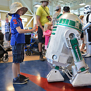 Marcus Parasciuc, 6, meets R2-M0 at the terminal during Aviation Fun Day at the Waterloo International Airport in Breslau on Saturday. <br /> <br /> IAN STEWART / SPECIAL TO THE RECORD