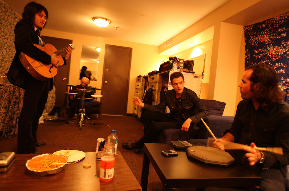 The post-punk band The Killers perform at the Hammerstein Ballroom at Manhattan Center Studios in New York, N.Y. on Oct. 24, 2008. Second to right and far right, singer Brandon Flowers and Drummer Ronnie Vannucci Jr. talk with touring musicians backstage before their show.