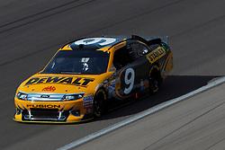 Mar 11, 2012; Las Vegas, NV, USA;  Sprint Cup Series driver Marcos Ambrose (9) during the Kobalt Tools 400 at Las Vegas Motor Speedway. Mandatory Credit: Jason O. Watson-US PRESSWIRE