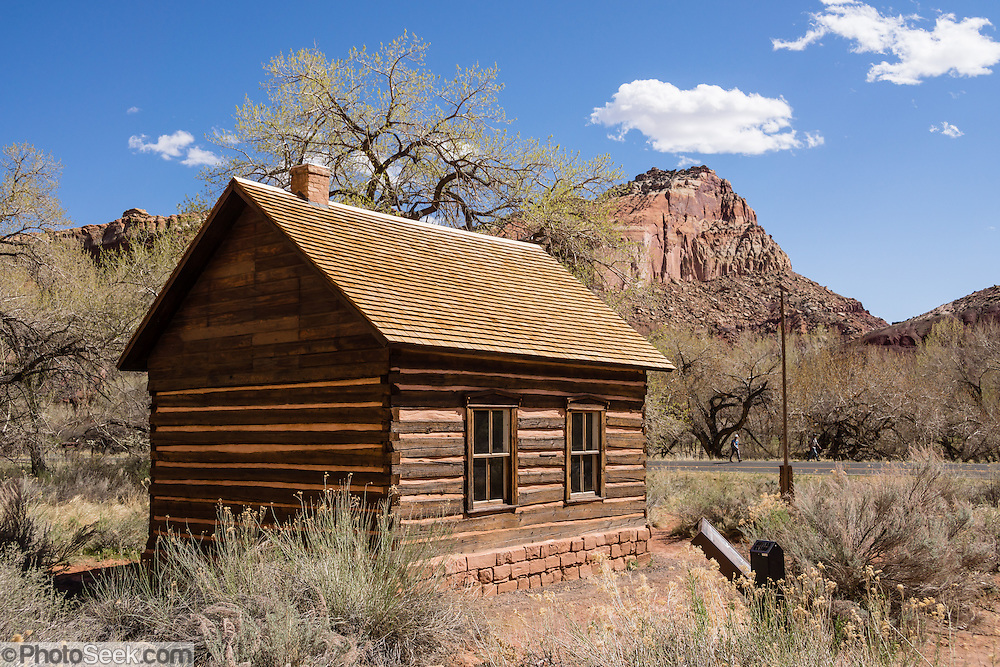 "Capitol Reef National Park, Utah, USA: Built in 1896, the Fruita one-room schoolhouse served as Mormon church & community center and schooled students until 1941. Established in 1880, the Mormon town of Junction became known as Fruita by 1904, also called ""The Eden of Wayne County"" for its large orchards. Fruita was abandoned in 1955 when the National Park Service purchased the town to be included in Capitol Reef National Park, later restoring the schoolhouse, Gifford house and barn."
