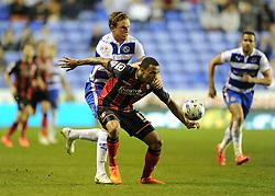Reading's Alex Pearce battles for the ball with Bournemouth's Callum Wilson - Photo mandatory by-line: Alex James/JMP - Mobile: 07966 386802 - 14/04/2015 - SPORT - Football - Reading - Madejski Stadium - Reading v AFC Bournemouth - Sky Bet Championship