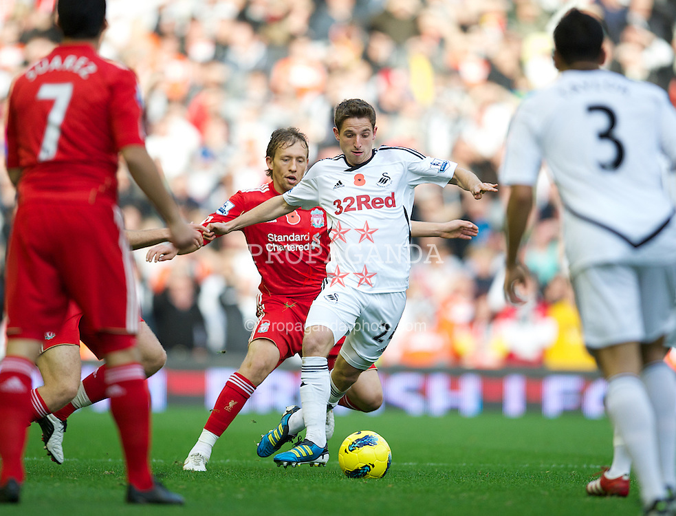 LIVERPOOL, ENGLAND - Saturday, November 5, 2011: Liverpool's Lucas Leiva in action against Swansea City's Joe Allen during the Premiership match at Anfield. (Pic by David Rawcliffe/Propaganda)