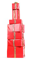Pile of red gift boxes Christmas presents stacked in a shape of an alcoholic beverage bottle isolated on white background.