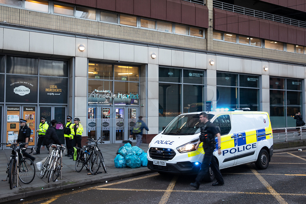 © Licensed to London News Pictures. 04/10/2019. Manchester, UK. Police are youngsters outside the Arndale Centre . GMP responded to an incident at the Arndale Centre in Manchester City Centre at which batons and CS gas were deployed against school children . GMP say they have arrested two 16 year olds on suspicion of having committed public order offences . Photo credit: Joel Goodman/LNP