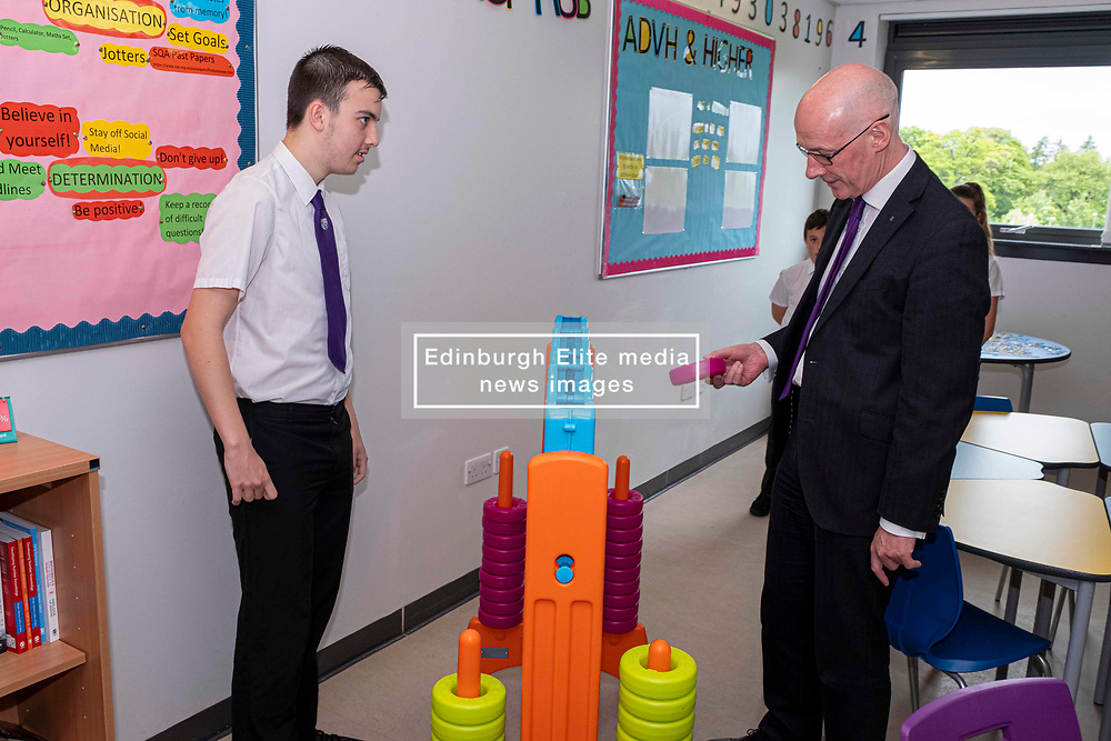 Pictured: John Swinney took up[ the challenge of connect four thrown down by Kieran McKenzie (S5).  Mr Swinney was glad he won.<br /><br />The Deputy First Minister visited Holy Rood High School in Edinburgh today to meet parents and pupils before announcing GBP50 million funding for improving attainment.  The results of a survey of headteachers were also published during the Deputy First Minister's visit.<br /><br /> Ger Harley | EEm 30 May 2019