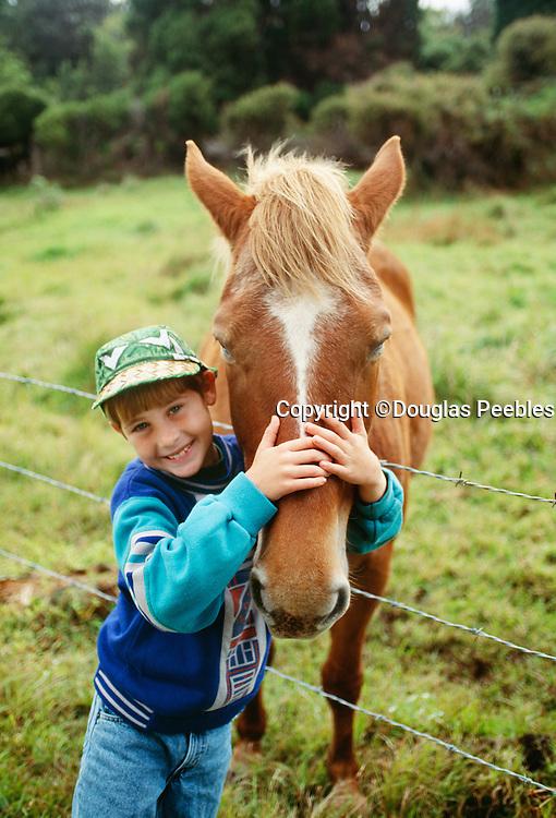 Boy with horse, Island of Hawaii