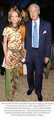 MR & MRS MARTIN SUMMERS he is the leading art dealer, at a dinner in London on 20th May 2002.	PAF 114