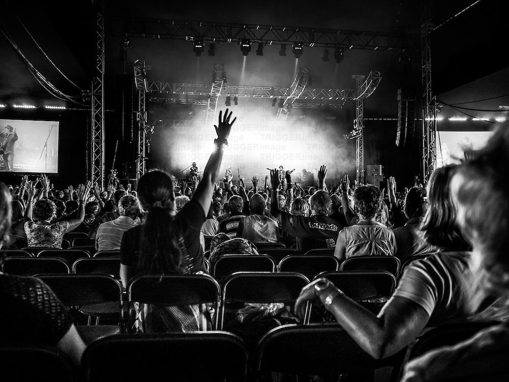 Audience waving at band on stage