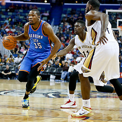 Dec 2, 2014; New Orleans, LA, USA; Oklahoma City Thunder forward Kevin Durant (35) drives past New Orleans Pelicans guard Jrue Holiday (11) during a game at the Smoothie King Center. The Pelicans defeated the Thunder 112-104. Mandatory Credit: Derick E. Hingle-USA TODAY Sports