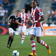 Stoke City F.C. Midfielder STEVEN N'ZONZI (15) dribbles the ball in front of him in the first half a MLS regular season international friendly match against the Philadelphia Union Tuesday, July. 30, 2013 at PPL Park in Chester PA.