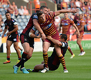 Lee Gaskell of Huddersfield Giants looks for a way through the Wigan defence during the Betfred Super League match at the John Smiths Stadium, Huddersfield<br /> Picture by Richard Land/Focus Images Ltd +44 7713 507003<br /> 12/07/2018
