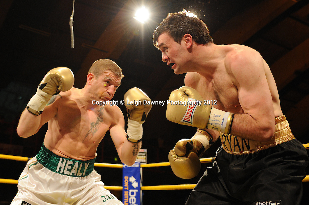 Ryan Greene (black shorts ) defeats Ciaran Healy in Quarter Final two at Prizefighter Middleweights, Kings Hall, Belfast, Northern Ireland on 5th May 2012. Promoted by Prizefighter/Matchroom Sport. © Leigh Dawney Photography 2012.