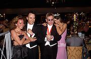 David Furnish, Sir Elton John and Elizabeth Hurley, Sir Elton John's White Tie and Tiara Ball. Windsor, 28 June 2003. © Copyright Photograph by Dafydd Jones 66 Stockwell Park Rd. London SW9 0DA Tel 020 7733 0108 www.dafjones.com