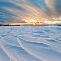snow drifts big sky winter blizzard setting sun