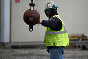 A worker prepares the crane arm for the delivery of four new transformers at the Robert Moses-Robert H. Saunders Dam in Massena on Wednesday, November 12, 2014.