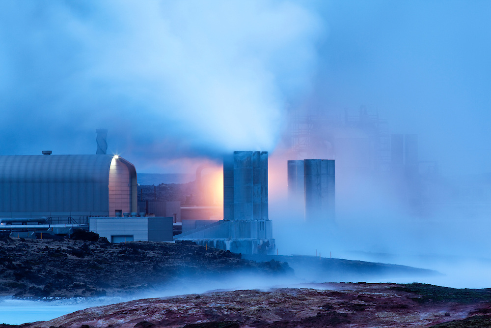 Iceland, Grindavik, Steam  billows from Reykjanes Geothermal Plant on spring evening