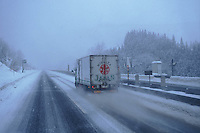 Nobuyuki is overtaken by another truck during a snow storm on a his way to Sapporo.