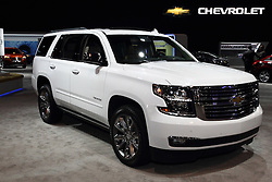12 February 2015:  2015 CHEVROLET TAHOE LTZ: Chevrolet brings the all-new 2015 Tahoe and Suburban to the 107th edition of the Chicago Auto Show, and bill the duo as the industry's best-selling full-size SUVs.  The 2015 Suburban represents the 80th anniversary and 12th generation of the original SUV. Fresh styling and improved aerodynamic advances the Tahoe and Suburban's design, and interesting, not a single exterior sheet panel or lighting element is shared with Chevy's full-size pick-ups. Projector-beam headlamps flank the Chevrolet-signature dual-port grille – chrome on all models – and sweep into the front fenders. high-intensity discharge headlamps and light-emitting diode daytime running lamps are included on the up level LTZ model. Eighteen-inch standard wheels that are a half-inch wider, reducing tire flex for improved cornering performance. Twenty- and 22-inch wheels are available. A more-efficient, direct-injected EcoTec3 5.3-liter V-8 develops 355 horsepower and 383 lb-ft of torque. The engine is connected to a Hydra-Matic six-speed automatic that includes TapShift control.  Inside, three rows of seating are standard on all models. Interior configurations can seat six- to nine-passengers, and behind the first-row seats, Suburban offers up to 137.4 cubic feet of cargo room, while Tahoe has a spacious 108.9 cu. ft.. Fold-flat second- and third-row seats enhance the cargo convenience – including an available power-folding feature. There is an optional rear-seat entertainment system that adds dual screens (Suburban only) and Blu-ray DVD player.<br /> <br /> First staged in 1901, the Chicago Auto Show is the largest auto show in North America and has been held more times than any other auto exposition on the continent. The 2015 show marks the 107th edition of the Chicago Auto Show. It has been  presented by the Chicago Automobile Trade Association (CATA) since 1935.  It is held at McCormick Place, Chicago Illinois
