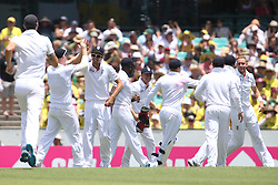 © Licensed to London News Pictures. 03/01/2014. The England team celebrate after Stuart Broad gets a wicket during the 5th Ashes Test Match between Australia Vs England at the SCG on 03 January, 2013 in Melbourne, Australia. Photo credit : Asanka Brendon Ratnayake/LNP