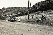 car with western people by the side of the road in mountainous landscape Morocco 1930s