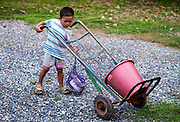 A Thai child wants to Help out on the farm. PHOTO BY LEE CRAKER
