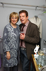 NINA CAMPBELL and NICKY HASLAM at a party hosted American House and Garden magazine with Tomasz Starzewski and Nina Campbell to celebrate the British Issue of the magazine, held at 14 Stanhope Mews West, London SW7 on 13th March 2005.<br />