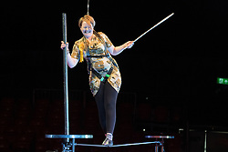 © Licensed to London News Pictures. 22/04/2015. Guildford, UK. Kelly-Marie Blundell is guided through the process by comedy artist Vladimir Georgieski and high wire walker Olga Roxhkovskaya. Liberal Democrat Kelly-Marie Blundell walks the high wire at Moscow State Circus in Guildford. Photo credit : Stephen Simpson/LNP