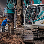Dill Crew member leveling Casagrande Drilling and Piling Rig.<br />